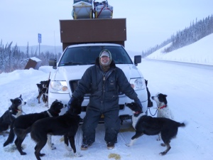 Dave dropping dogs outside of Whitehorse.  the gang's dog truck has pickets for each dog, so when Dave is traveling to the Quest he can stop every couple hours to let them out to pee.  Two sleds are better than one!  Dave's main sled is a super light Gatt sled but he always brings a backup in case something should occur!