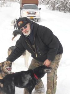 Lee Lowry has been a friend to Dave and the Gang since 1992, when he met Dave while acting as Business Manager for the Yukon Quest.  Since '92, Lee has handled for Dave in several races, kept the home fires buring in Healy when the team was traveling, and coached rookie handlers through their first experiences handling on the Quest.  Lee is currently the human companion to world-famous Dalton Gang Lead Dog - now retired - Ganges.